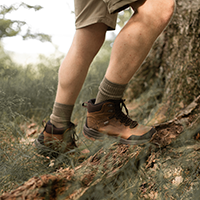 Legs of a man on a hike wearing hiking boots