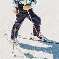 Person wearing ski pants riding on skis