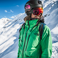 Woman wearing a green The North Face Sku jacket with snow in the background